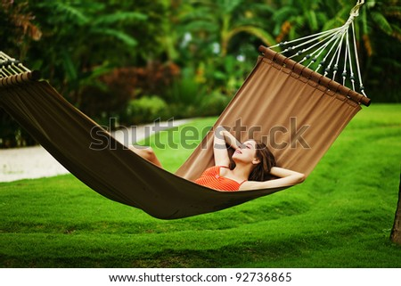 Young beautiful woman in hammock, Bali, Indonesia