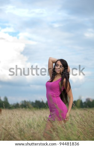 Young beautiful woman in pink dress