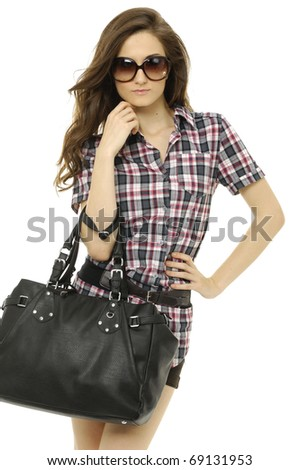 young beautiful woman in short skirt and sunglasses, with black leather handbag, isolated on white - stock photo