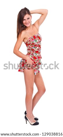 Young beautiful woman in short summer dress posing to camera - isolated