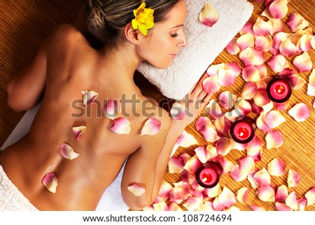 Young beautiful woman in Spa massage salon. Relax.