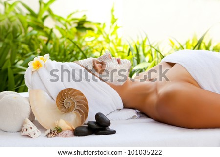 Young beautiful woman in tropical spa