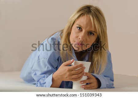 young beautiful woman is drinking coffee indoor #151039343