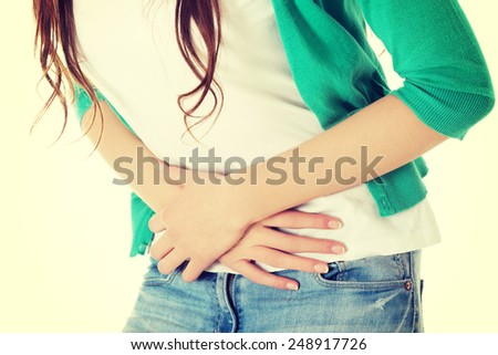 Young beautiful woman is having stomach ache.