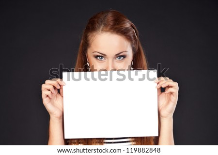 Young  beautiful woman is holding empty text board