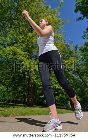 Young beautiful  woman jogging on morning at  park. Woman in sport outdoors health concept