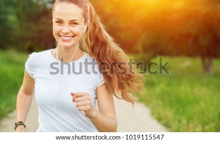 Young beautiful woman jogging workout training #1019115547