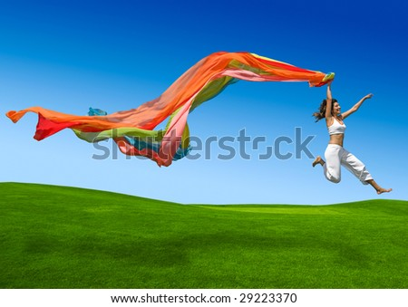 Young beautiful woman jumping with a scarf - Different Version