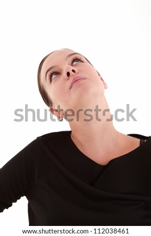 Young beautiful woman looking up with copy space