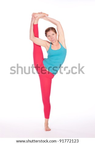 Young beautiful woman makes yoga exercise isolated on white background in studio