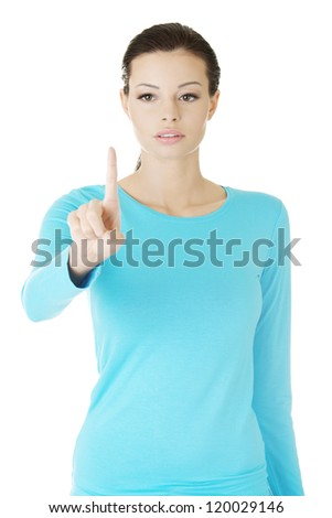 Young beautiful woman making choose on abstract screen - stock photo