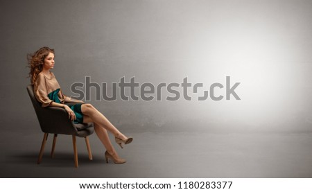 Stock Photo Young beautiful woman modeling in an empty studio