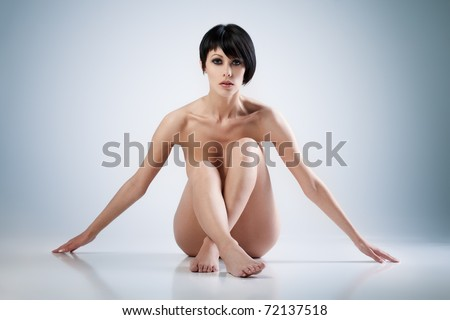 Young beautiful woman on blue background