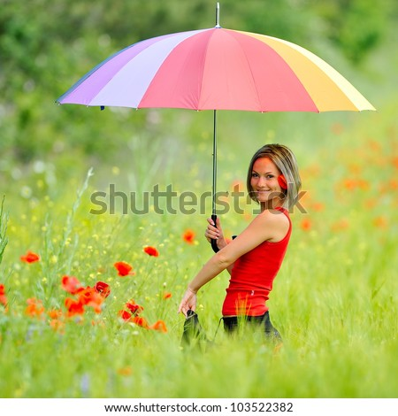 young beautiful woman on cereal field in summer - stock photo