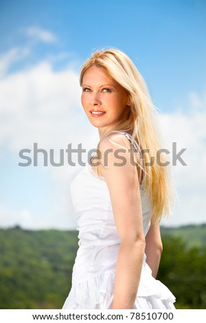 Young beautiful woman on green field, outdoor portrait, summer fun concept