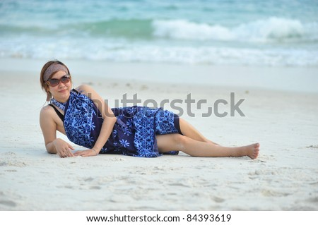 young beautiful woman on sea background