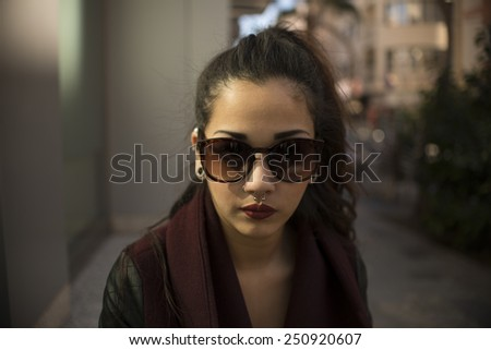 Young beautiful woman on street #250920607