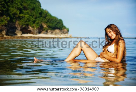 Young beautiful woman on the beach, bali