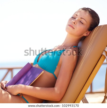 Young beautiful woman sea side vacation