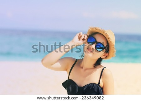 Young beautiful woman on the beach, Woman with sunglasses in bikini. (Color Process) #236349082