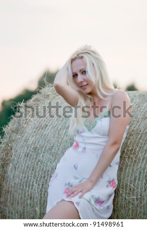 young beautiful woman on the summer field