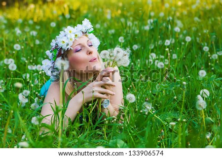 young beautiful woman outdoors at spring