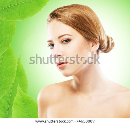 Young beautiful woman over green natural background