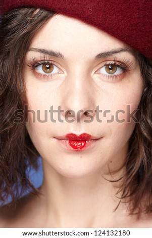 young beautiful woman playing with heart drawing on lips. Valentine's day