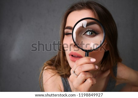 Young beautiful woman portrait looks painful eye lens search on Internet information employer does not find pop-up error 404 in browser issuing popular system queries unique selection optimization.