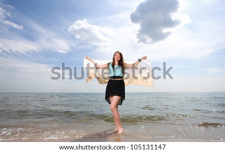young beautiful woman portrait on the beach