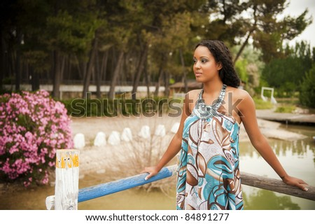 Young beautiful woman posing with summer dress
