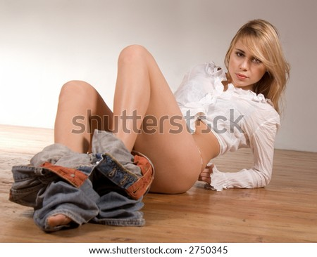 young beautiful woman putting clothes out - stock photo