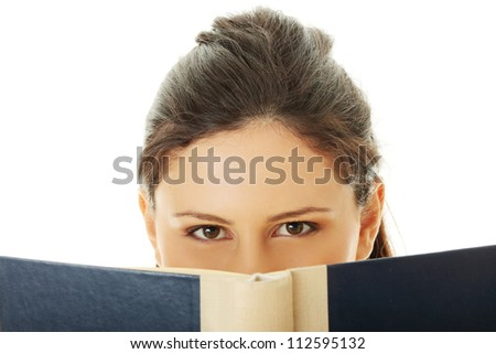 Young beautiful woman reading book