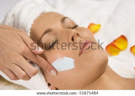 Young beautiful woman receiving a facial