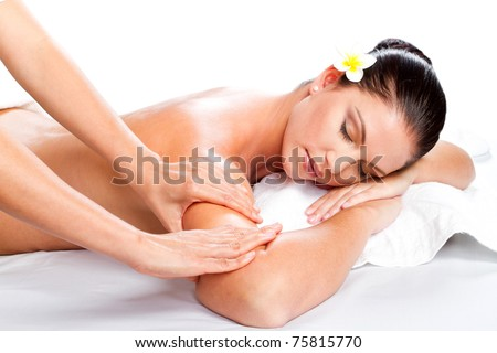 young beautiful woman receiving massage over white