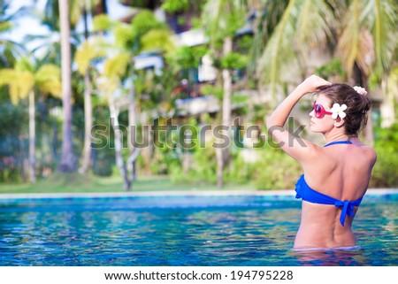 young beautiful woman relaxing in spa pool