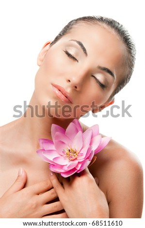 Young beautiful woman relaxing with lotus flower isolated on white background, professional beauty makeup