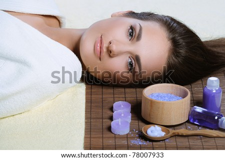 Young beautiful woman resting after spa procedures - stock photo
