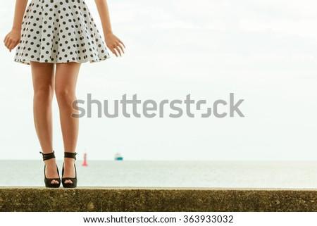 young beautiful woman retro styling wearing polka dot dress high heels outdoor #363933032
