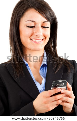 Young beautiful woman sending a sms