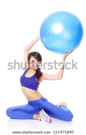 Young beautiful Woman sitting and holding fitness ball up in full length isolated over white background, model is a asian girl