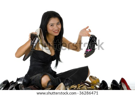 young, beautiful woman sitting with her shoes, isolated on white