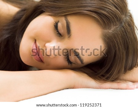 Young beautiful woman sleeping on bed - stock photo