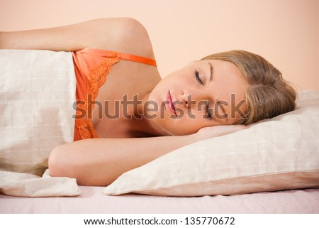 Young beautiful woman sleeping on bed,Bedtime