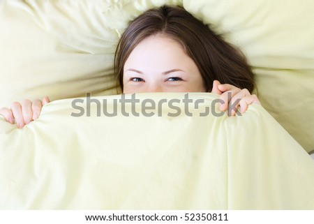 young beautiful woman smiling in the bed