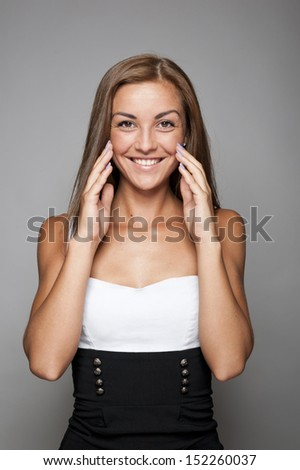 Young beautiful woman smiling on white background