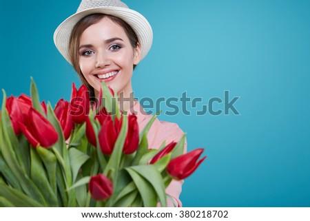 Young beautiful woman studio portrait with tulip flowers Stok fotoğraf ©
