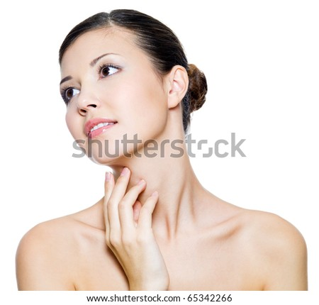 Young beautiful woman touching by fingers her neck - isolated on white background