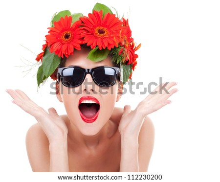 young beautiful woman wearing a gerbera wreath and sunglasses being excited about something on a white background