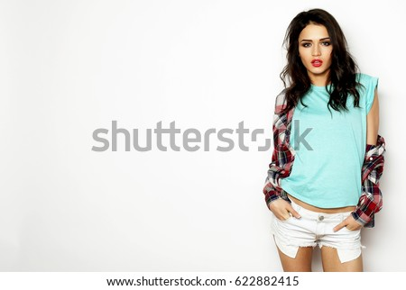 Young beautiful woman wearing casual clothes, posing on white background #622882415